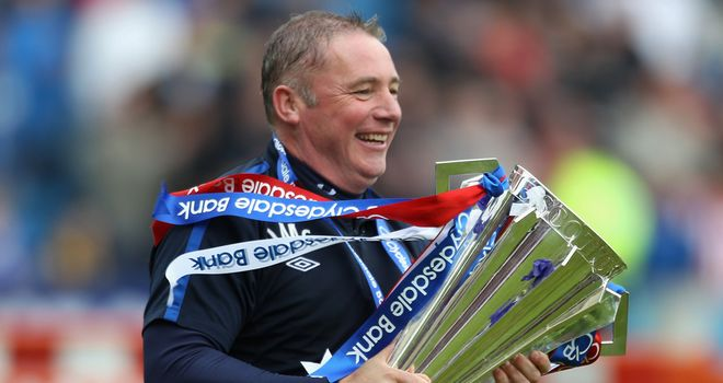 Ally McCoist: The then-assistant boss to Walter Smith with the 2010/11 trophy.