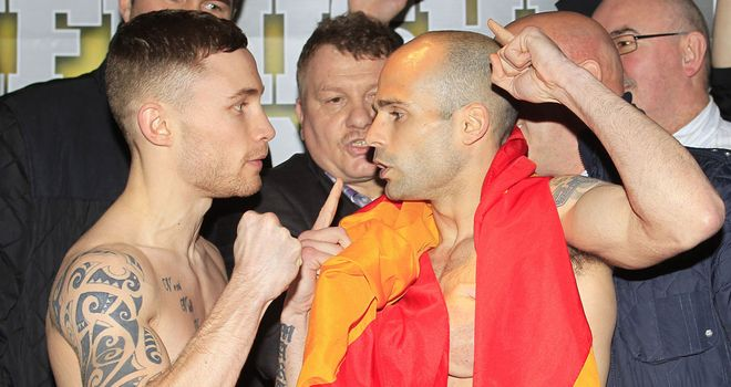 Carl Frampton (L) and Kiko Martinez kick-off at the weigh-in