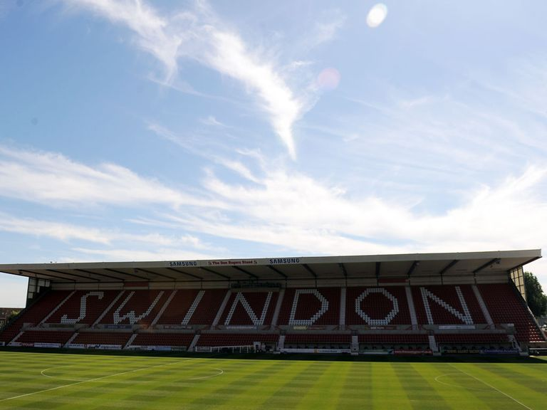 Swindon have added two players from Tottenham.
