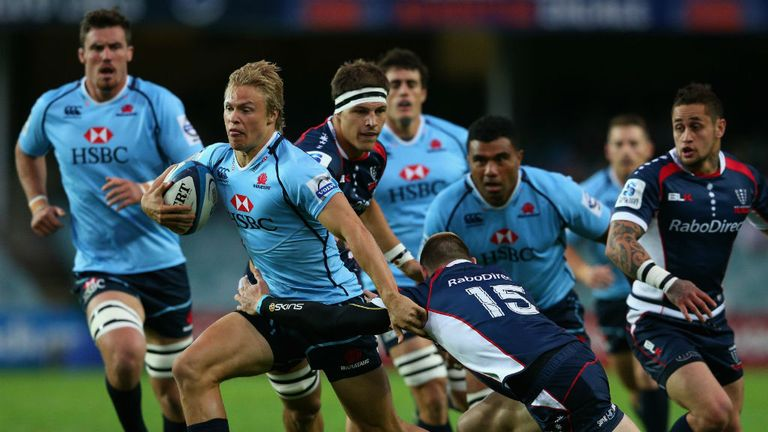 Tom Kingston on the attack for the Waratahs