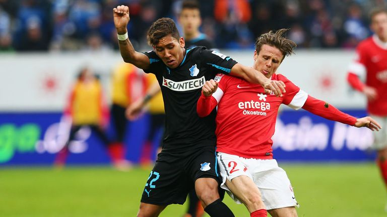 Roberto Firmino and Nicolai Mueller tussle for the ball