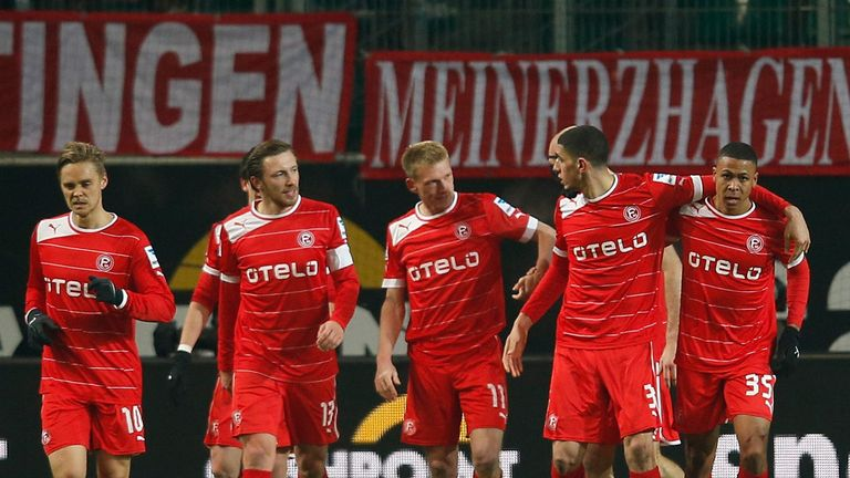 Fortuna Dusseldorf celebrate Mathis Bolly's goal