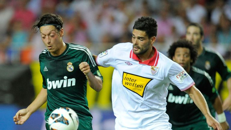 Alberto Botia (r): Tussles with Real Madrid's Mesut Ozil