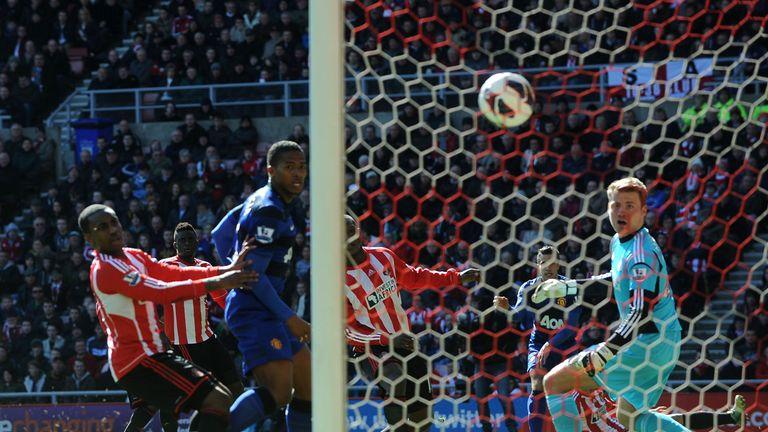 Titus Bramble diverts Robin van Persie's shot into the net