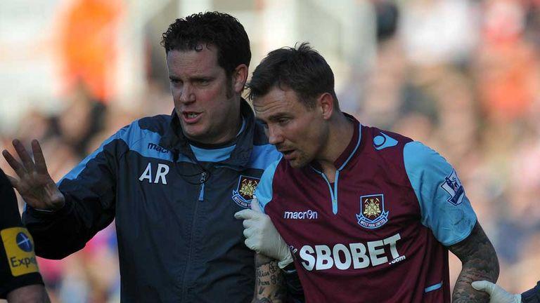 Matthew Taylor: West Ham midfielder is helped off the field at Stoke
