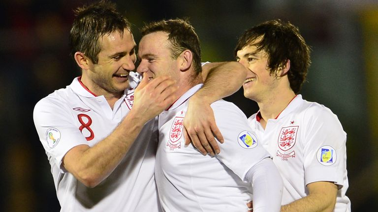 Job done: Lampard, Rooney and Baines celebrate their 8-0 win
