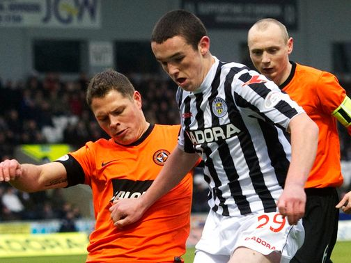 John Rankin battles for the ball with John McGinn