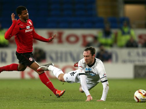 Richard Keogh is fouled by Fraizer Campbell