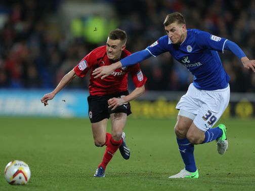 Craig Noone and Chris Wood battle for the ball
