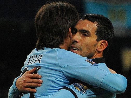 Hat-trick Carlos Tevez celebrates at the Etihad
