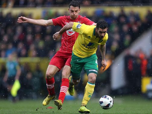 Jay Rodriguez tries to stop Bradley Johnson