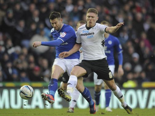 David Nugent is challenged by Derby's Jeff Hendrik