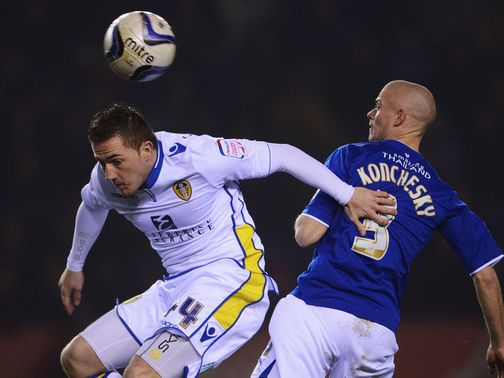 McCormack and Konchesky challenge for a high ball