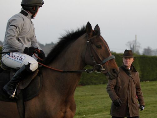 Quevega works under the watchful gaze of Willie Mullins