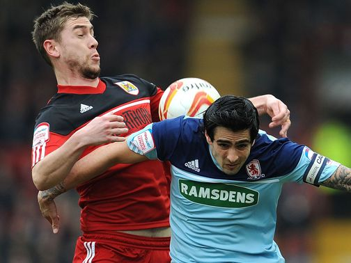 Steven Davies and Rhys Williams sandwich the ball