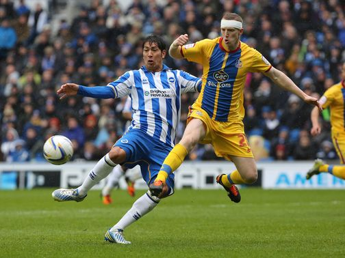 Leonardo Ulloa and Peter Ramage battle for the ball
