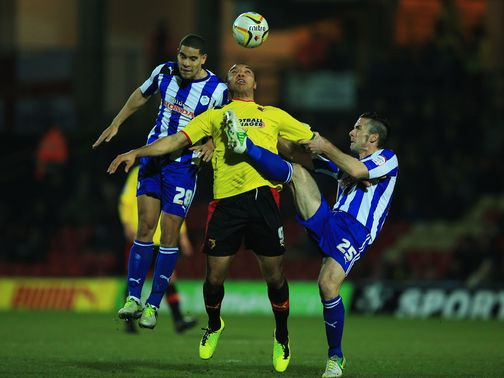 Deeney battles for the ball under pressure from Coke and Prutton