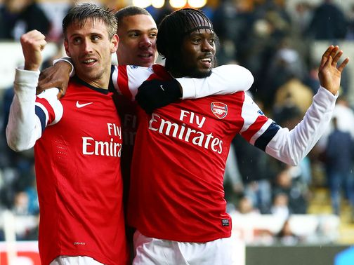 Arsenal: Monreal and Gervinho celebrate