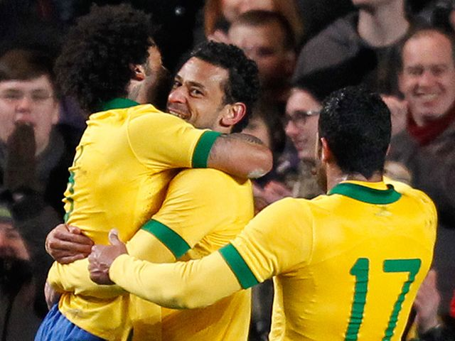 Fred celebrates after drawing Brazil level