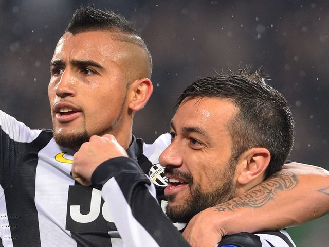 Fabio Quagliarella celebrates his goal with Arturo Vidal