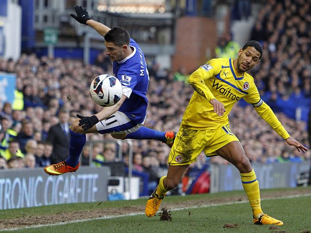 Kevin Mirallas tangles with Jobi McAnuff