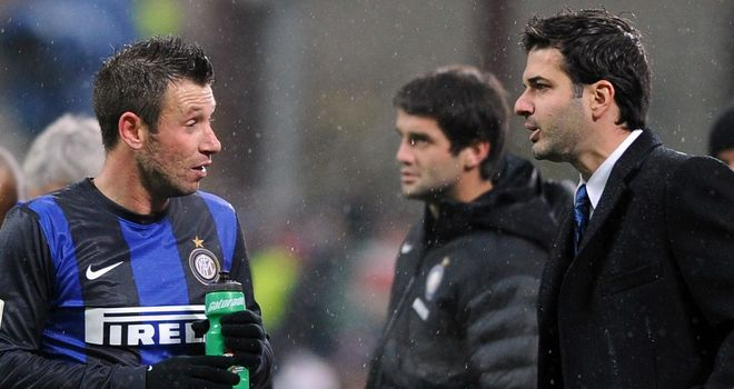 Andrea Stramaccioni, right, has played down his 'discussion' with Antonio Cassano, left