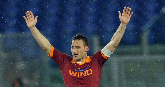 Francesco Totti: Celebrates his landmark goal