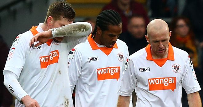 Gary MacKenzie: Struck (L) struck late for Blackpool