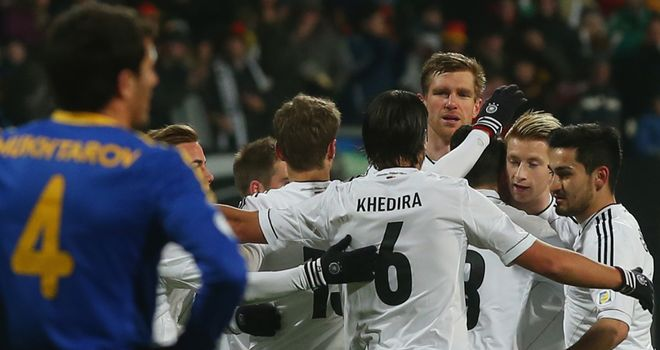 Germany celebrate after scoring through Marco Reus
