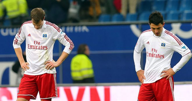 Hamburg's Marcell Jansen (l) and Tolgay Arslan are left dejected