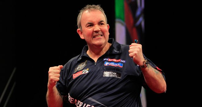 Phil Taylor: World champion defeats Raymond van Barneveld