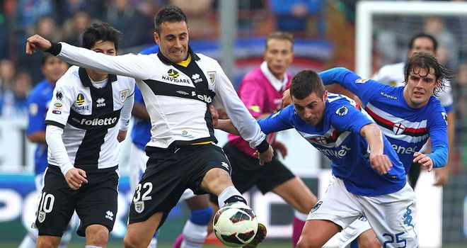 Marco Marchionni and Nenad Krsticic vie for the ball