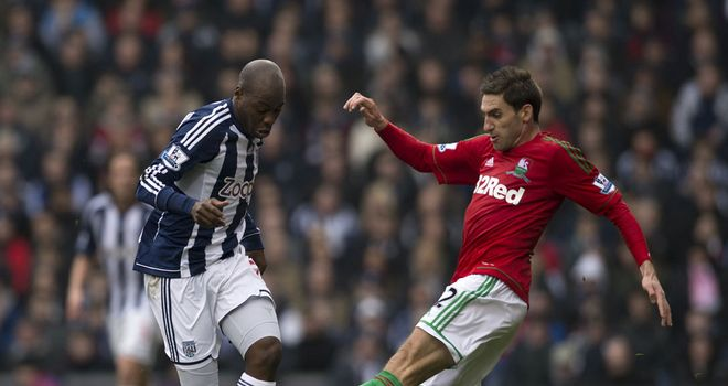 Angel Rangel: Swansea defender in action against West Brom