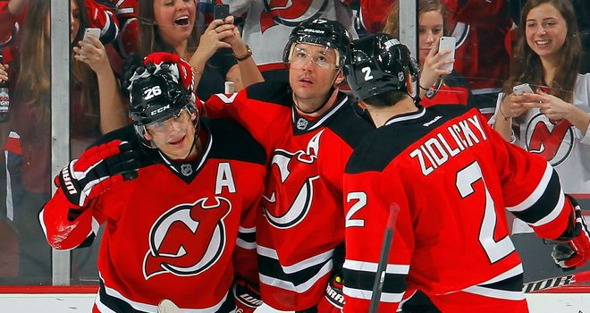 Patrik Elias (c) celebrates with Ilya Kovalchuk and Marek Zidlicky