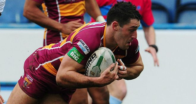 Joe Wardle: Huddersfield centre defended by Paul Anderson