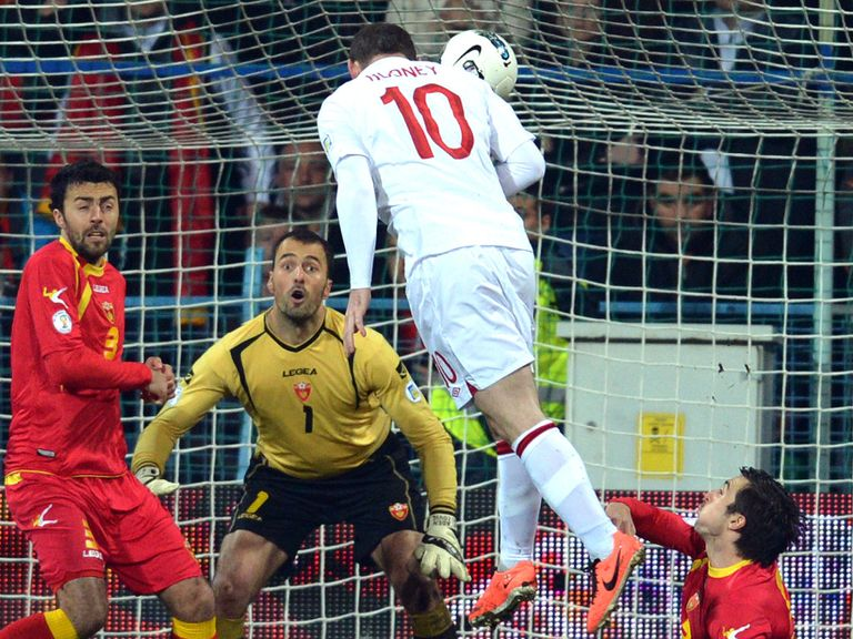 Wayne Rooney heads home against Montenegro.