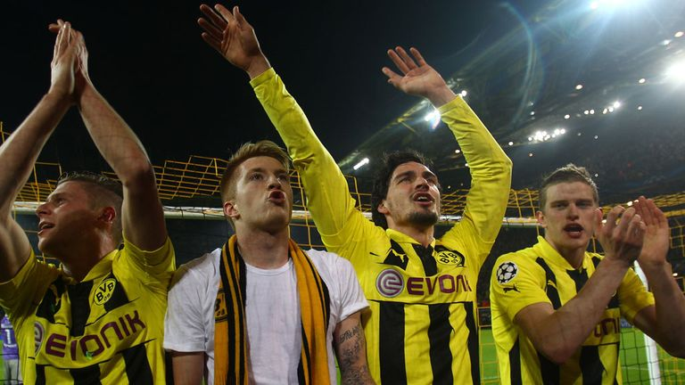 Dortmund's players thank a set of supporters key to the club's success and identity