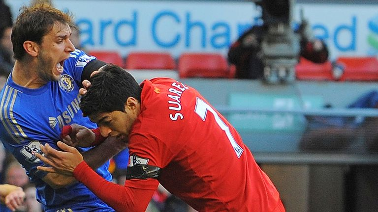 Luis Suarez attacks Branislav Ivanovic during Liverpool's 2-2 draw with Chelsea