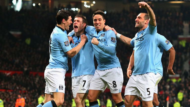 Manchester City celebrate after James Milner opened the scoring