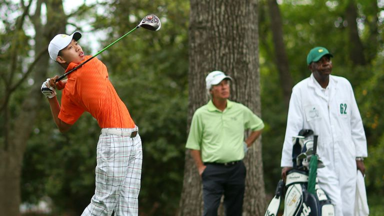 Ben Crenshaw looks on as Guan Tianlang drives off