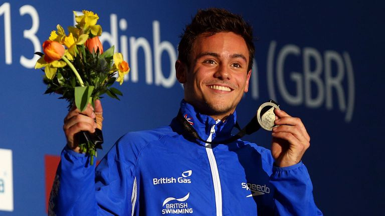Tom Daley celebrates his victory in Edinburgh