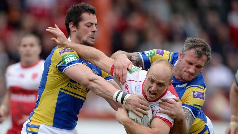 Michael Dobson is tackled by Ian Kirke and Jamie Peacock