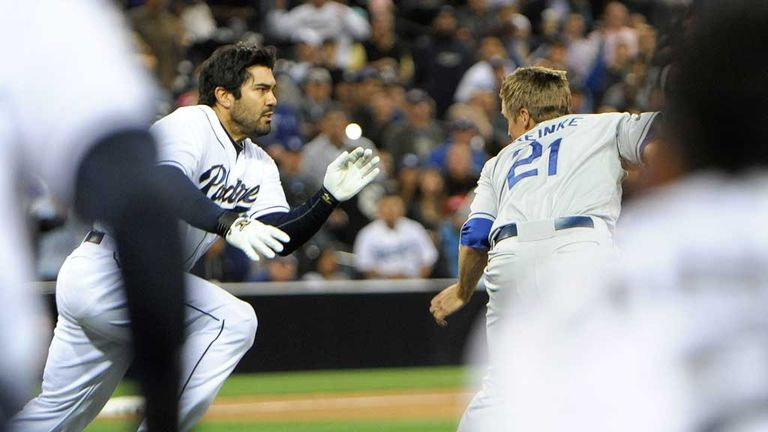 Collision course: Carlos Quentin charges at Zack Greinke