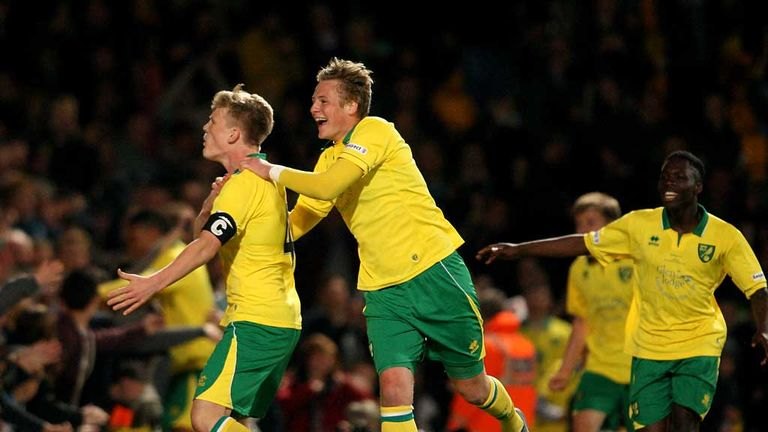 Cameron McGeehan: Norwich captain celebrates his late penalty against Chelsea