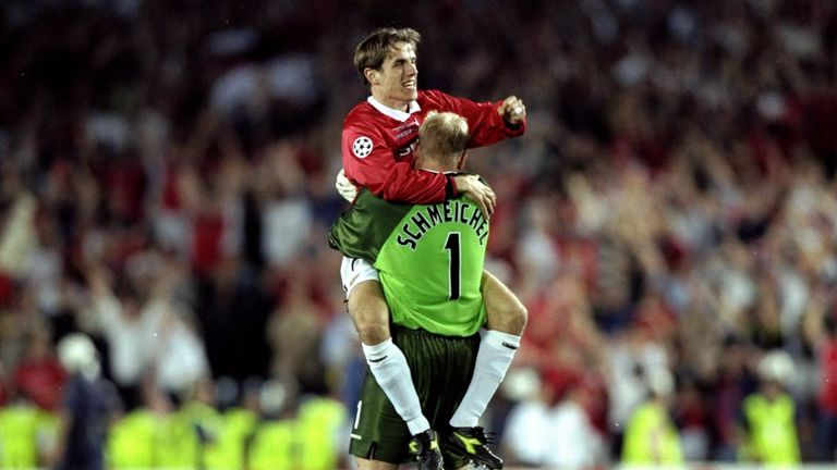 Phil Neville and Peter Schmeichel of Manchester United celebrate victory over Bayern Munich