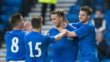Chris Hegarty (second from right) celebrates scoring in the friendly victory over Linfield