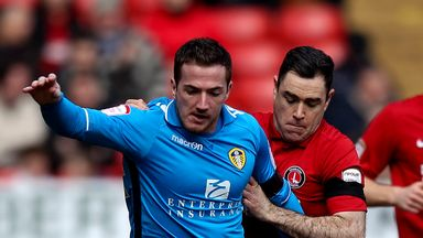 Andy Hughes: Gets to grips with Leeds striker Ross McCormack