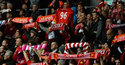 Liverpool supporters hold scarves and shirts during a memorial service on the 24th anniversary of the Hillsborough disaster