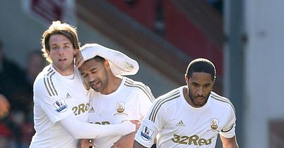 Luke Moore (centre): Leaves Swansea by mutual consent