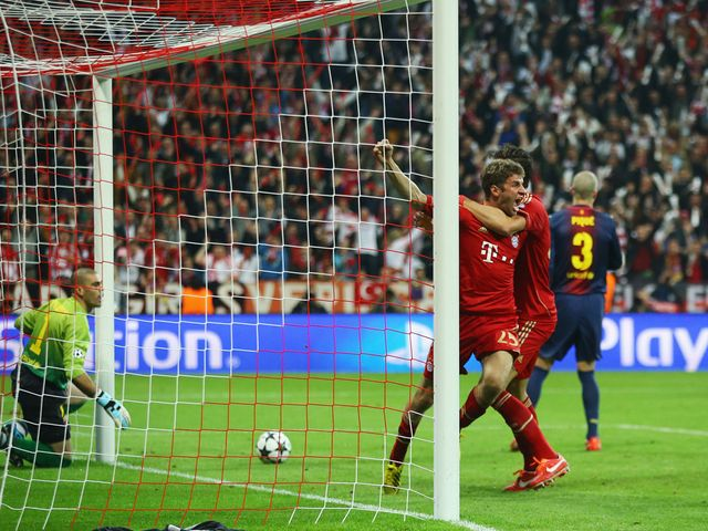 Thomas Muller celebrates the opening goal for Bayern Munich